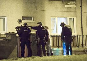 Scenes from the dramatic swoop by heavily-armed police on a house in Aspen Walk in Belfast in the early hours of yesterday morning