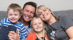 Stephen Clements with his wife Natasha and their children Poppy and Robbie