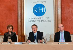 Inquiry chairman Sir Patrick Coghlin (centre), Dame Una O'Brien and Dr Keith MacLean at the launch event to publish the RHI Inquiry Report at Stormont yesterday