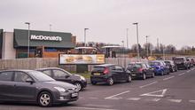 A large queue of cars leading into a McDonald's restaurant on Belfast's Shore Road after the company announced it would be closing all its food outlets due to the coronavirus pandemic