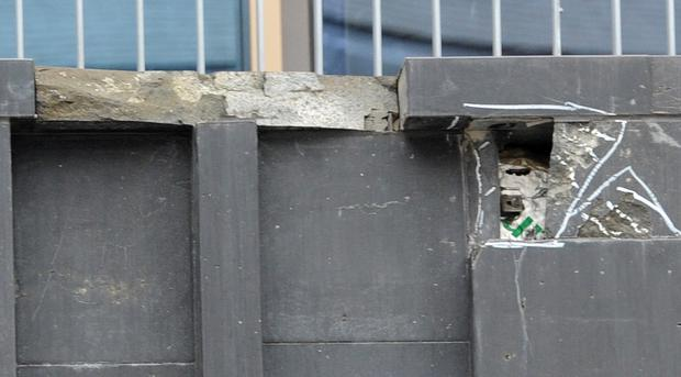 Crumbling: The exterior brickwork of the Mac in Belfast appears to be in considerable disrepair, with stone tiles falling off the six-storey building