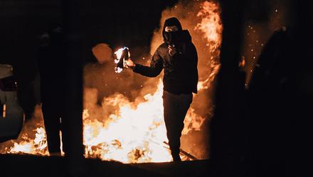 Violence: A rioter prepares to throw a petrol bomb in Carrickfergus