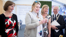 Secretary of State Karen Bradley samples food at the Moy Park stand at the Balmoral Show yesterday