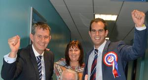 Luke Poots (right) at the counting hall after his election as a DUP councillor for Lisburn and Castlereagh in 2014. Congratulating him were his father, former Health Minister Edwin Poots, and mother Glynis