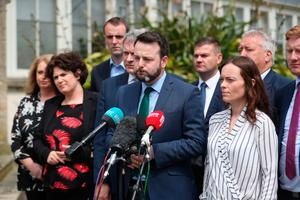 Colum Eastwood with party colleagues at Stormont