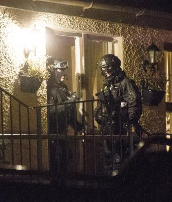 Police officers during Monday night's raid
