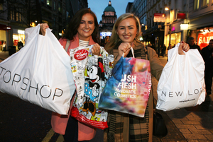 Sisters Lucy and Shannon McClurnan laden with bargains