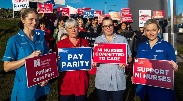 Health service staff take part in industrial action outside the Ulster Hospital