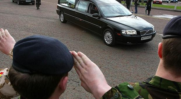 The coffins of sappers Patrick Azimkar and Mark Quinsey leaving Massereene Barracks in Antrim