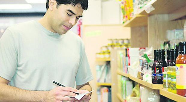 A Generic photo of a man checking his shopping list in a supermarket. See PA Feature MONEY Food Bills. PA Photo/JupiterImages Corporation. WARNING: This picture must only be used to accompany PA Feature MONEY Food Bills.
