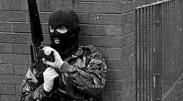 Images from the Belfast Telegraph Troubles Gallery. Belfast IRA man on patrol in West Belfast 1987 - Pacemaker