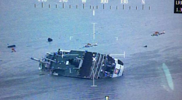 One passenger rescued from the Korean ferry said he believed many people were trapped inside the vessel when it sank. The ferry is pictured above as the rescue work continues off the coast of Jindo Island on April 16, 2014 in Jindo-gun, South Korea.