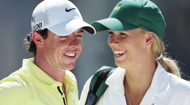 Caroline acting as Rory's caddy