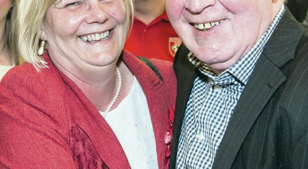 Angela Dobbins of the SDLP celebrates with party colleague John Tierney after being elected
