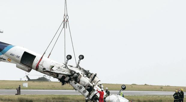 The remains of the shattered Manx2.com aircraft are removed from the crash site at Cork Airport in February 2011. Six people, including the two pilots, died in the disaster