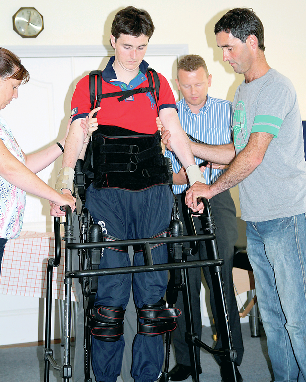 Jonjo Bright walking in his Ekso Bionic suit for the first time