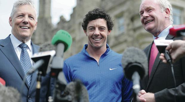Peter Robinson and Martin McGuinness with Rory McIlroy at Stormont after the golfer's success at The Open