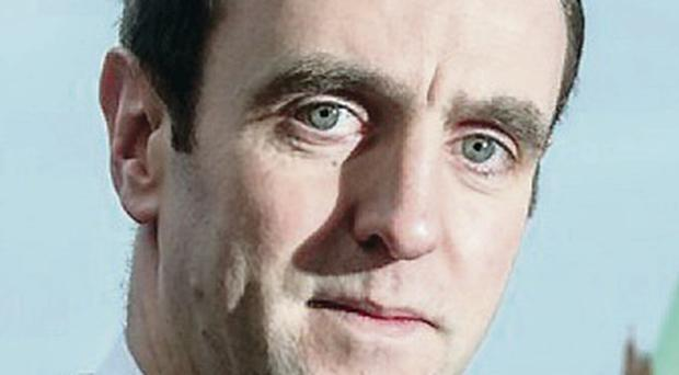 Mark H Durkan says the drop in price will save new drivers over £400,000 a year