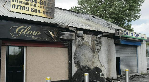 An arsonist destroyed three adjoining shops in Poleglass