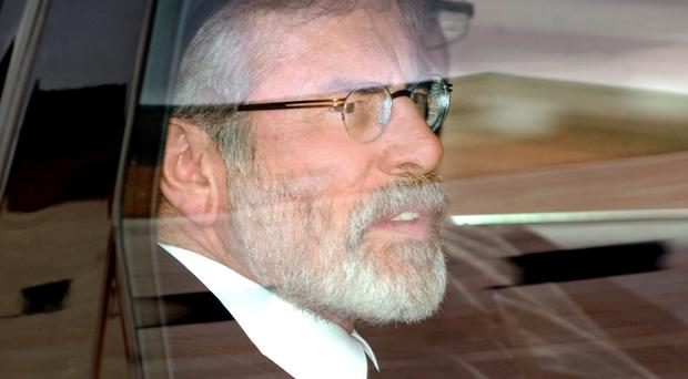 Gerry Adams is driven from Belfast Crown Court after giving evidence in the trial last year of his brother Liam