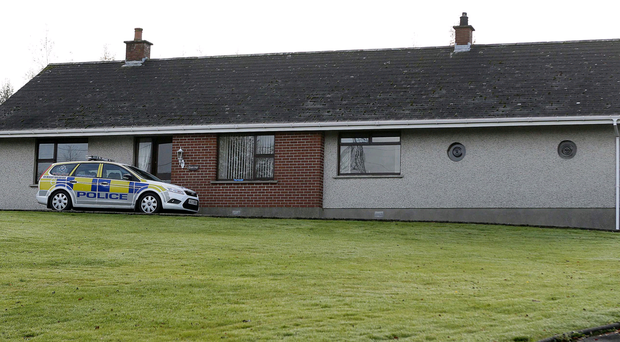 A police car yesterday at the house on the Dagger Road in Lisburn where a man died in a fire