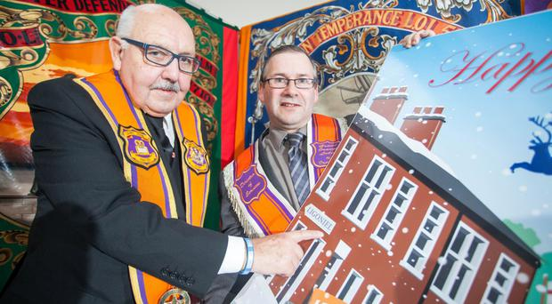Two of the cartoon cards, shown off by Orange Order Belfast grand master George Chittick and director of services Dr David Hume