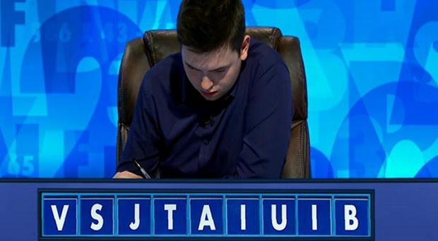 Laurence grappling with a Countdown word puzzle