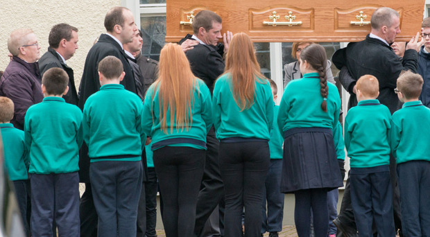 An honour guard of local school children at the funeral of Donegal farmer Seamus Hegarty