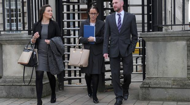 Sarah McKinley, whose grandmother is a patient at the facility, Sinn Fein councillor Cara McShane and campaign organiser Ruari Morgan leave the High Court in Belfast following yesterday's interim judgment on the threatened closure of the Dalriada Hospital multiple sclerosis respite unit