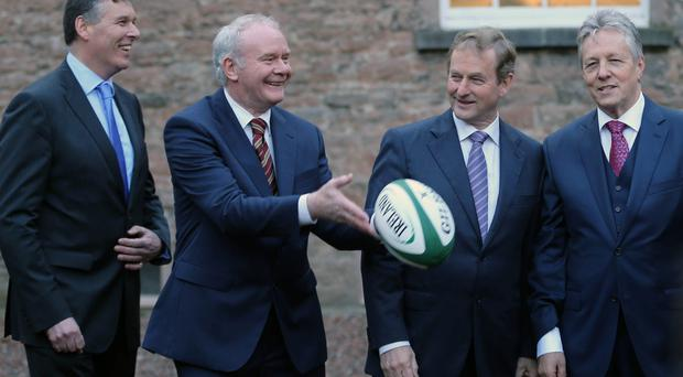 Philip Browne (IRFU), Deputy First Minister Martin McGuinness, Taoiseach Enda Kenny and First Minister Peter Robinson during the launch of the all-Ireland bid to host the 2023 Rugby World Cup at the the Royal School, Armagh, yesterday