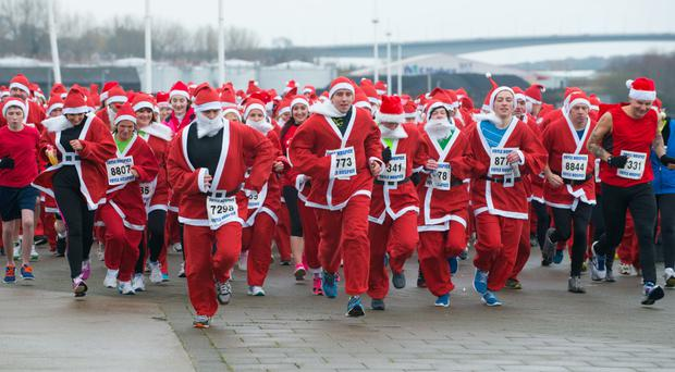 Participants in the annual Santa Dash/Stroll in aid of the Foyle Hospice