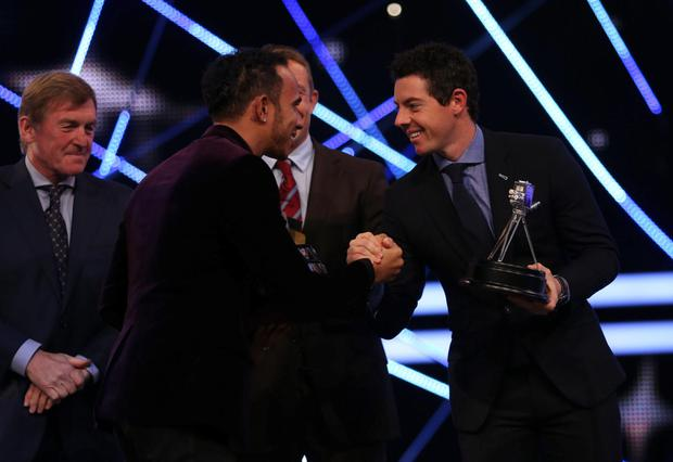 Rory McIlroy congratulates the winner Lewis Hamilton after finishing runner-up