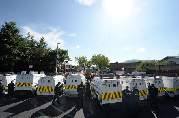 A protest at the interface area at Twaddell Avenue, Belfast, is monitored by PSNI officers