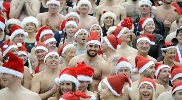 Hundreds of people took part in the annual Santa Splash at East Strand in Portrush yesterday