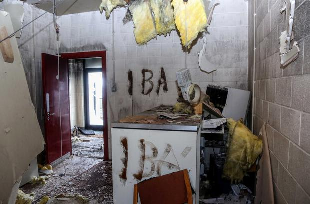The fire-ravaged and graffiti-covered interior of the Sport and Leisure Swifts Football Club building on Glen Road in west Belfast