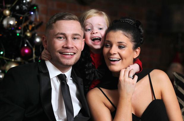 Boxing champion Carl Frampton at home in Lisburn with his wife Christine and their daughter Carla