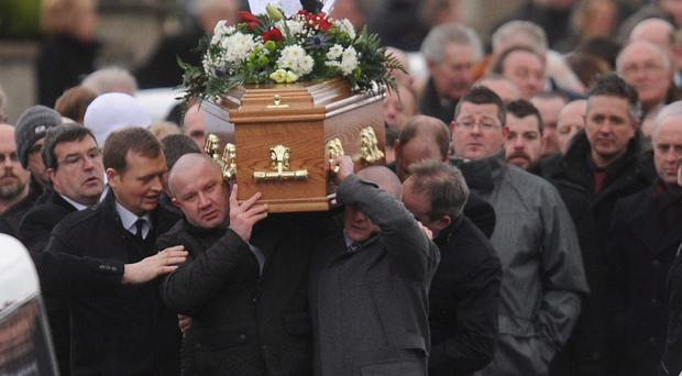 Family and friends carry the coffin of murder victim Brian McIlhagga during his funeral in Ballymena yesterday
