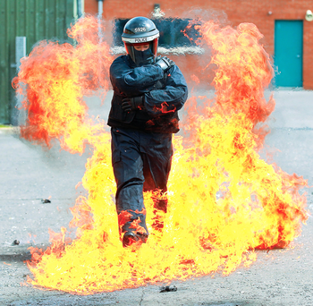 Telegraph's Deborah McAleese is engulfed in flames during riot training at Ballykinler