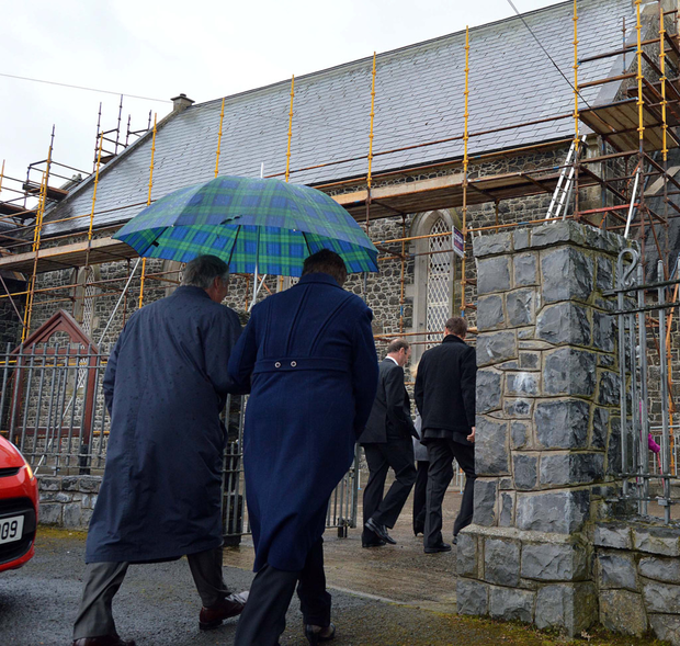 Parishioners enter Knocknamuckley Parish Church in Co Armagh, which is at the centre of an ongoing dispute over a rector's style of ministry