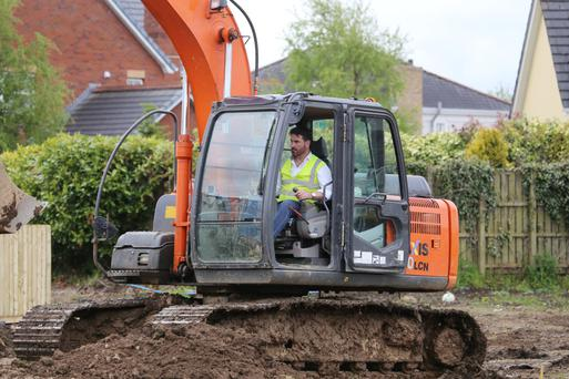 Michael Taggart operating a digger at the building site in Limavady