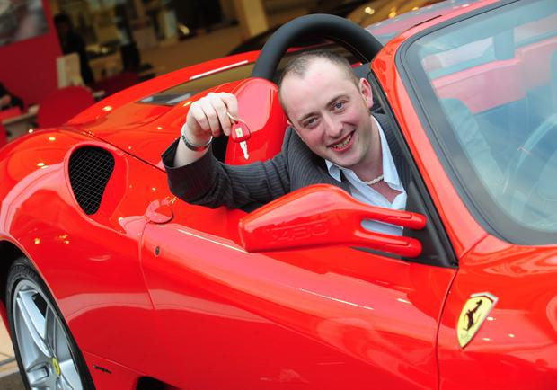 Lottery winner Ryan Magee with the Ferrari he bought