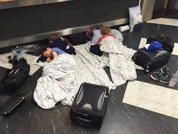 Passengers sleeping on the floor at Belfast International Airport on Saturday night after their flight was diverted