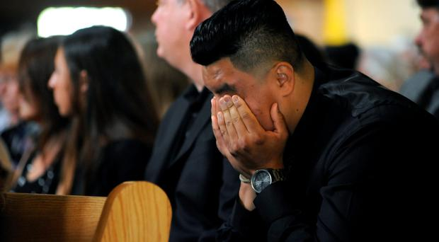 Grief: mourner weeps at service