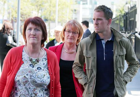 Sean Hackett's mother Eilis (centre) leaving court yesterday