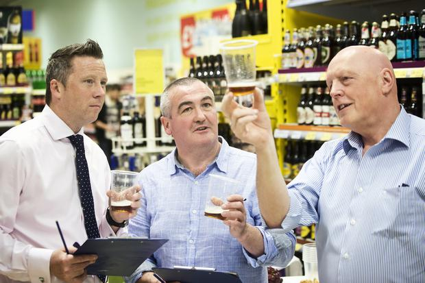 Steven Murphy, Tesco NI's buying manager, Bernard Sloan from Whitewater Brewing Co and Oliver McCann from P McCann and Sons