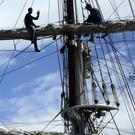 Workers aboard a Tall Ship at the Odyssey