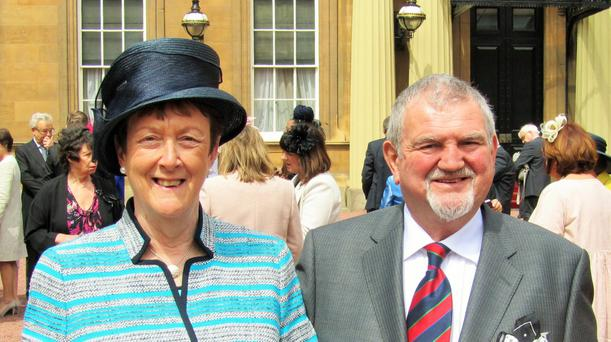 John Hanna and his wife Councillor Joan Baird taken at Buckingham Palace in May as Joan receives her OBE