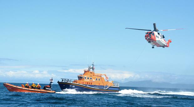 A helicopter and lifesavers involved in the rescue off Rathlin yesterday