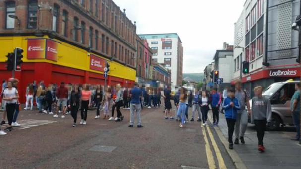 The scene in the Castle Street area of Belfast after 200 youths turned up to watch an organised fight yesterday