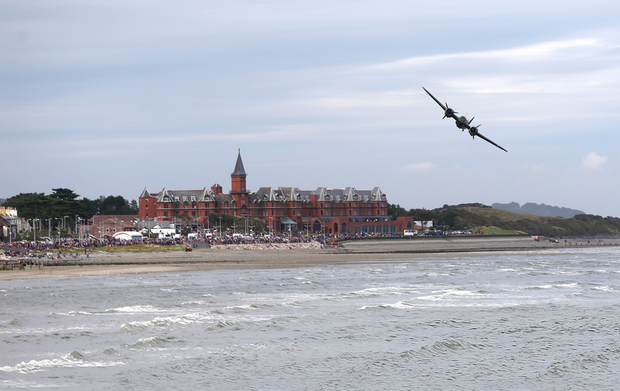 A bomber flies over the Slieve Donard Hotel during the Festival of Flight in Newcastle